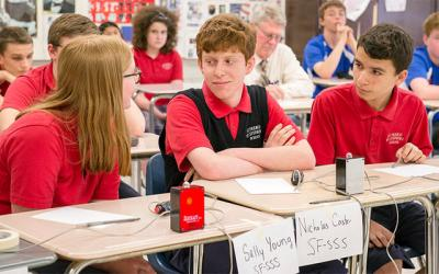 <p>Sally Young, Nicholas Caster and Brady Dorrington, Academic Challenge Bowl members from St. Francis-St. Stephen School in Geneva, take part in the Rochester-area playoffs May 10 in Fairport. (Courier photo by John Haeger) </p>