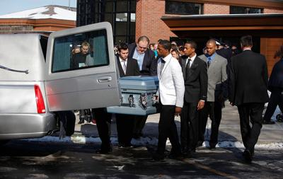 Members of the Silver Lake College of the Holy Family men's basketball team in Manitowoc, Wis., carry the coffin of Stephen D. Smith after the Jan. 29 funeral Mass for Smith, Tyler Doohan and Lewis J. Beach at St. John's of Rochester Catholic Church in Fairport, N.Y. The players traveled 12 and a half hours from Manitowoc to be pallbearers after hearing how Tyler, age 9, died saving six relatives from a fire that destroyed his grandfather's upstate New York home. Beach and Smith also died in the fire.