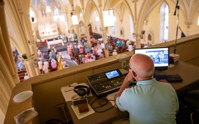 <p>Video operator Mike Paulin controls the cameras at Corning's St. Mary Church during a Sept. 15 Mass. (Courier photo by Jeff Witherow)  </p>