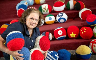 <p>Gina Mangiamele&rsquo;s vision of praying for peace around the world turned into The Giant Mary Queen of Peace International Rosary Project, a 55-foot-long, five-decade rosary featuring beads crocheted to depict the flags of different countries.  </p>