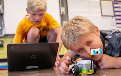 <p>Fifth-grader Ronan Turkavich (left) and second-grader Owen Schubert work on programming their Lego robot during a robotics class at Canandaigua&rsquo;s St. Mary School June 20. (Courier photo by Jeff Witherow)  </p>
