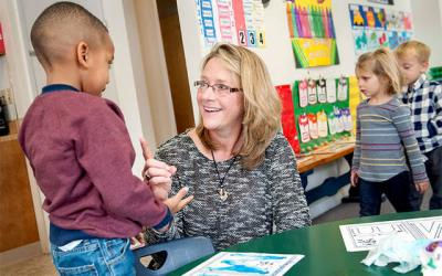 <p>Jean Yorio visits with prekindergartners in January 2016 during her first year as principal of St. Mary Our Mother School in Horseheads. As of Aug. 1, Yorio also began serving in the same capacity at Elmira&rsquo;s Holy Family School. (File photo)  </p>