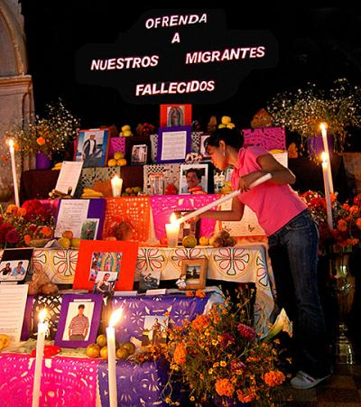 A woman is pictured in a 2009 photo lighting a candle at an altar that is built in advance of the Day of the Dead every year at Divine Savior Parish in Malinalco, Mexico. The altar is to remember the migrants from Malinalco who died while working in the United States.