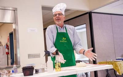 """<p>""""The Bread Man"""" Chet Fery prepares to knead dough during his presentation at St. Mary Church in Honeoye Aug 22. (Courier photo by John Haeger)  </p>"""