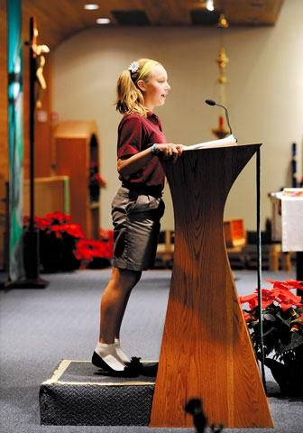 Hayley Izard, a fifth-grader at Christ the King School in Irondequoit, speaks during a prayer service Jan. 13.