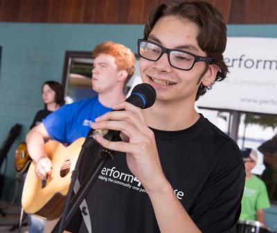 <p>Dante Liberatore sings with Perform 4 Purpose Aug. 5 at the Owasco Yacht Club. Dante, a parishioner of Holy Family in Auburn, received the diocesan St. Cecilia Award for high-school music minsters this past spring. (Courier photo by John Haeger) </p>