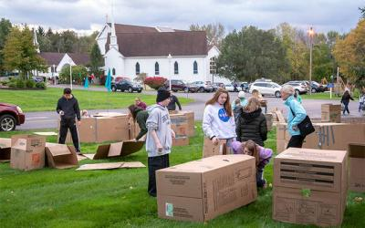 <p>Youths from St. Catherine of Siena Church in Mendon and St. Patrick Church in Victor camp on the grounds of the Mendon church Oct. 13 using shelters made from cardboard boxes. (Courier photo by Jeff Witherow)  </p>