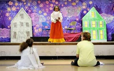 """Eight-year-old Arianna Colbert reads lines from the play """"Oliver Twist"""" during Light of Christ Parish's theater camp at the former St. Andrew School in Rochester July 29. (<a href=""""http://catholiccourier.smugmug.com/Events/2010-Light-of-Christ-Theatre/13393370_ochtK#974357013_mTfb4"""" target=""""_blank"""">Click  here</a> to view more photos from this event and/or buy prints.)"""