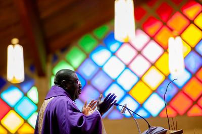 Father Peter Enyan-Boadu, pastor of Greece's St. John the Evangelist Parish, delivers the homily during an April 9 Mass.