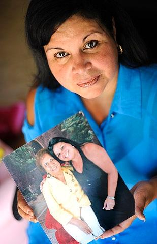 Gloria Martínez of Rochester holds a photo of herself and her mother, Eleuteria Rivera, who passed away in August 2011 after receiving hospice care.