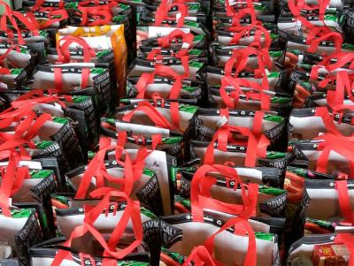 <p>Bags containing Christmas food items for people in need are lined up in the rectory garage of Holy Cross Church in Rochester, awaiting delivery on Dec. 16 by volunteers. (Courier photo by Mike Latona) </p>