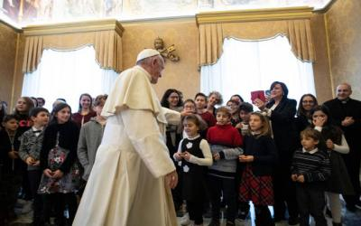 <p>Pope Francis greets a delegation from the children and teens section of Italy's Catholic Action during an audience at the Vatican Dec. 20. (CNS photo by Vatican Media)  </p>