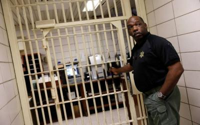 <p>Warden Dennis Grimes opens the doors to holding cells in the East Baton Rouge Parish Prison in Baton Rouge, La., March 5. The federal government could start shaving the size of its prison populations in the wake of the First Step Act becoming law. (CNS photo by Shannon Stapleton/Reuters)  </p>