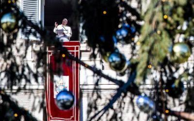 <p>Pope Francis leads the Angelus from the window of his studio overlooking St. Peter's Square at the Vatican Dec. 26. (CNS photo by Claudio Peri/EPA)  </p>