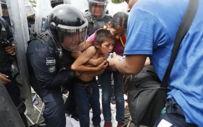 <p>A young boy heading to the United States with other migrants from Central America is given water by Guatemalan police Dec. 19. On Dec. 24, an 8-year-old Guatemalan child detained by U.S. Customs and Border Protection died at a hospital in New Mexico, the agency reported, the second migrant child to die in government custody in December. (CNS photo by Esteban Biba/Reuters)  </p>