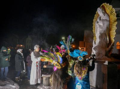 <p>Father Jesus Flores blesses a statue of Our Lady of Guadalupe outside the Mission of Our Lady of Guadalupe in Marion Dec. 12. (Courier photo by John Haeger) </p>