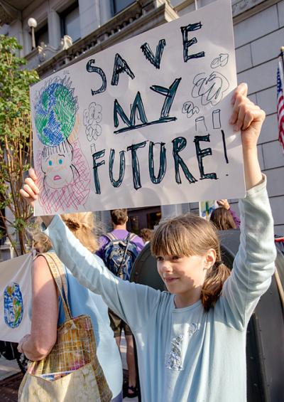 Hannah Sommers, 12, protests with Mothers Out Front Sept. 24.