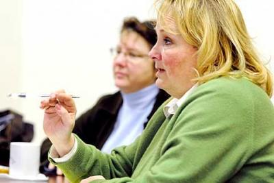 Ellen Wayne (above right), executive director of Catholic Charities of the Finger Lakes, says more and more new families are seeking help due to the difficult economy.