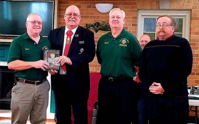 <p>Grand Knight Steve Koch (from left) poses with State Deputy Ken Latham and fellow Knights Bernie Vanderwall and Wally Lannon after receiving the Father McGivney Award Feb. 23 at St. Anne Church in Rochester.  </p>