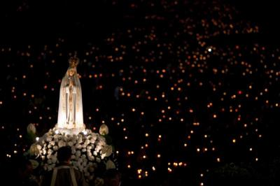 A statue of Mary is carried through the crowd in 2013 at the Marian shrine of Fatima in central Portugal.