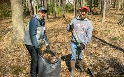 <p>Tanner Harris and Joe Kuchinski participate in a Tioga County Rural Ministry cleanup day April 8, 2017. (Photo courtesy of Tioga County Rural Ministry)  </p>