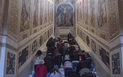 <p>Pilgrims at the Scala Santa ascend on their knees the steps that Jesus is said to have walked up on the way to his sentencing by Pontius Pilate. (Courtesy of Aaron Kelly) </p>