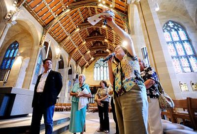 Ginny Miller (with microphone), music minister for Rochester's Cathedral Community, leads a tour of Sacred Heart Cathedral in August 2009.