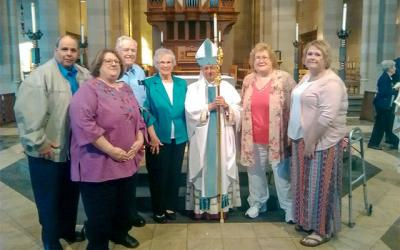 Eugene and Shirley VanDeWalle (center) with son-in-law and daughter Ron and Kathy Maiorani (left), Bishop Salvatore R. Matano and daughters Laurie Gavigan and Karen Ambroz (right) at the Marriage Jubilee Mass at Sacred Heart Cathedral May 19. (Photo courtesy of Laurie Gavigan)  </p>