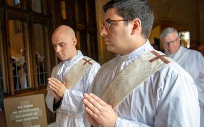 <p>Then-Deacons Matthew J. Walter (left) and Daniel L. White process into Rochester&rsquo;s Sacred Heart Cathedral at the start of the priestly ordination Mass June 1. (Courier photo by Jeff Witherow)  </p>
