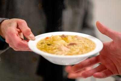 Soup is served at a soup supper and Living Stations of the Cross event at Rochester's Our Lady of the Americas Church March 4, 2009.