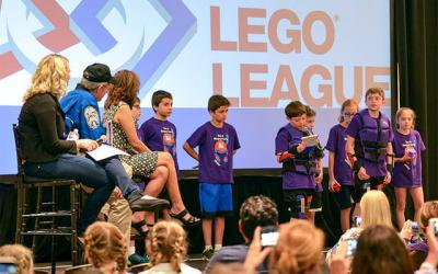 <p>The Eight Magneteers present their innovation project, Magnetic Dodgeball, to three experts and the other robotics teams at FIRST LEGO League Global Innovation Award in San Jose, Calif., July 2. (Photo courtesy of Ed Rivera)  </p>