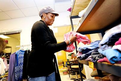 Volunteer Tracy Williams works in the clothing closet at Catholic Family Center's Community Resource Services branch in Rochester in 2010.
