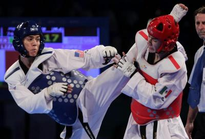 Steven Lopez of the U.S. battles with Mexican Rene Lizarraga during the 2013 Taekwondo World Championship in Mexico. Lopez, bound for his fifth Olympic Games in Rio de Janeiro, is a parishioner at St. Theresa Catholic Church in Sugar Land, Texas.