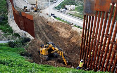<p>Construction workers in the U.S. work on a new section of the border wall as seen from Tijuana, Mexico, Feb. 18. The Supreme Court ruled July 26 that the Trump administration could use Pentagon funds to pay for construction and repairs of a wall along the border. (CNS photo by Jorge Duenes/Reuters)  </p>