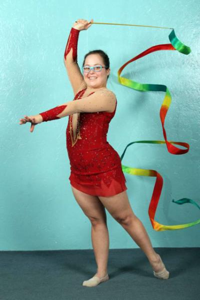 Lani DeMello, 30, pictured in a Dec. 8 photo, earned the title of World Champion in Rhythmic Gymnastics at the Down Syndrome International Gymnastics World Championships in Mortara, Italy. DeMello, a parishioner at Holy Trinity Church in Peachtree City, Ga., earned a silver medal performing with the ribbon.