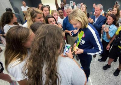 U.S. Olympic swimmer Katie Ledecky greets fans at Dulles International Airport in Virginia Aug. 17, after returning home from the Summer Games in Rio de Janeiro.