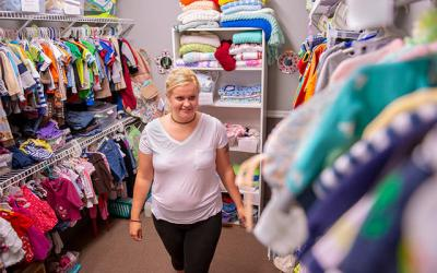 <p>Molly Steirer shops the selection of children&rsquo;s clothes available at Geneva&rsquo;s Family Hope Center Sept. 24. (Courier photo by Jeff Witherow)  </p>