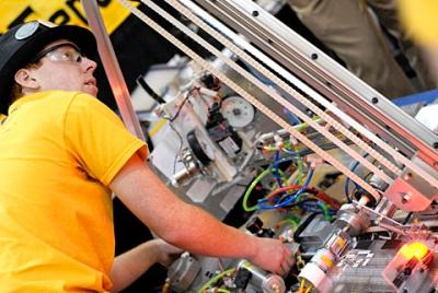 McQuaid Jesuit senior Griffin Orr works on a robot during the FIRST Robotics Competition March 5 at Rochester Institute of Technology.