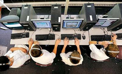 Eighth-graders in a computer-technology class at Siena Catholic Academy play games after completing their class work June 8.