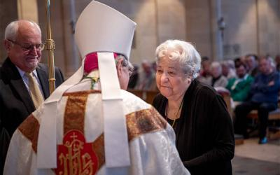 <p>Mary Camobreco, founder and longtime director of Birthright in Ithaca, accepts a Vita Award from Bishop Salvatore R. Matano during the annual Respect Life Mass Oct. 6 at Rochester&rsquo;s Sacred Heart Cathedral. (Courier photo by Jeff Witherow)  </p>