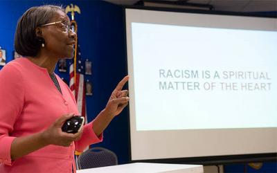 <p>Attorney Judy Toyer gave a presentation Oct. 23 at Church of the Assumption in Fairport as part of a six-session series on racism. (Courier photo by John Haeger)  </p>
