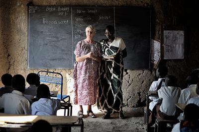 Sister Elizabeth Ryan, an Irish member of the Faithful Companions of Jesus who trains teachers, stands alongside Nyachingowk Laa in 2010 at the Bander Boys School, a government-run primary school in Malakal, South Sudan. Sister Ryan was trapped in Malakal during heavy fighting between rebel soldiers and government troops that broke out just before Christmas.