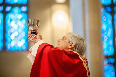 Bishop Salvatore R. Matano elevates the chalice during a Nov. 6 Mass at Rochester's Sacred Heart Cathedral. (Courier photo by Mike Crupi)