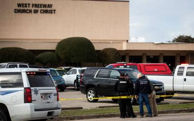 <p>Police and fire department officials in White Settlement, Texas, surround West Freeway Church of Christ Dec. 29. A gunman killed two parishioners there that same day. (CNS photo by Yffy Yossifor/Fort Worth Star-Telegram/TNS/ABACAPRESS.COM via Reuters)  </p>