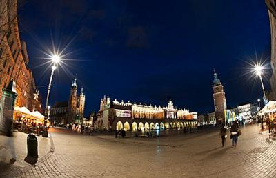 The city's main square and St. Mary's Basilica are seen in a nighttime view of Krakow, Poland. The polish city, the former see of soon-to-be saint Blessed John Paul II, will host the next international gathering of World Youth Day in 2016.