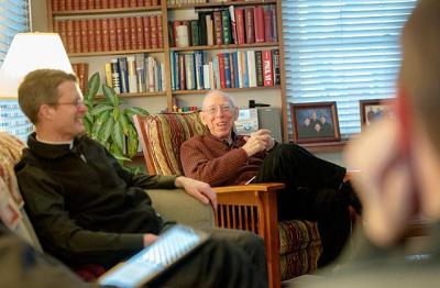 Basilian Fathers Morgan Rice (left) and Joseph Trovato share a light moment during a Feb. 9, 2015 Scripture reflection at the Christ the King rectory in Irondequoit. (Courier file photo)