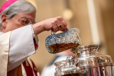 <p>Bishop Salvatore R. Matano pours balsam into oil for the Sacred Chrism. (Courier photo by Jeff Witherow)  </p>