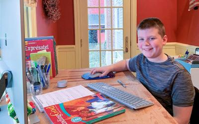 <p>Freddie Collins, a sixth-grader at All Saints Academy in Corning, completes independent school work in his converted playroom at home. (Photo courtesy of Nicholas Ferratella)  </p>