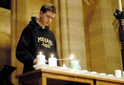 <br>Kyle Padden lights a candle after reading a Sikh prayer for peace Jan. 24 during a teen prayer vigil at Sacred Heart Cathedral.