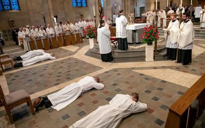 <p>The four deacon candidates prostrate themselves during the May 2019 deacon ordination. (Courier photo by Jeff Witherow)  </p>